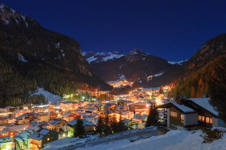 winter  house: Night in Alps - european skiing resort Canazei Stock Photo