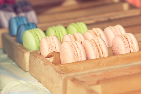 Delicious sweet buffet with colorful macarons in a  box. Shallow depth of field photo