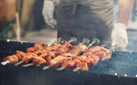 bbq party: juicy delicious Grilled meat steaming on barbecue