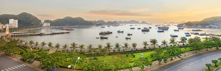 ba: Traditional  wooden blue fishing boats in the ocean, Cat Ba island, Halong Bay, Vietnam. Panorama from viewpoint.