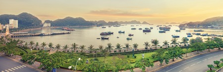 cat island: Traditional  wooden blue fishing boats in the ocean, Cat Ba island, Halong Bay, Vietnam. Panorama from viewpoint
