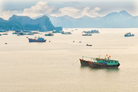 gentle dream vacation: Traditional blue wooden fishing boats in the ocean, Vietnam, Asia Stock Photo