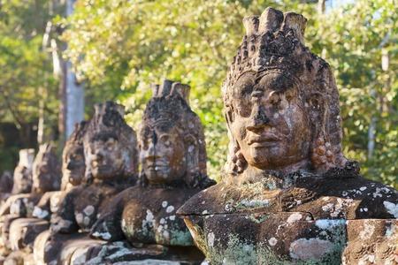bayon: Bayon temple stone carvings along the bridge