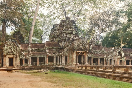 ta: Ta Prohm famouse gate covered with tree roots Stock Photo