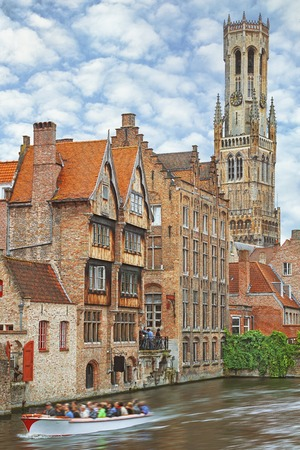 Traditional medieval red brickwall architecture of Bruges on water canals, Belgium