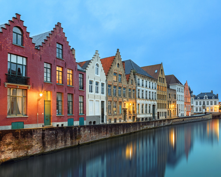 pitched: Traditional medieval red and white brickwall architecture of Bruges at twilight Stock Photo