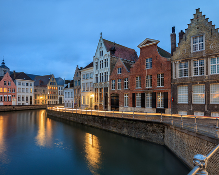 Traditional medieval red and white brickwall architecture of Bruges at twilight Stock Photo