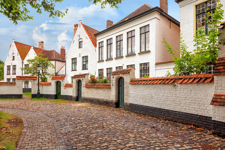 benelux: Traditional medieval red and white brickwall architecture of Bruges on blue sky background