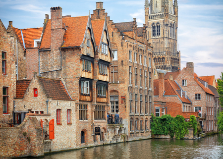 pitched roof: Traditional medieval red brickwall architecture of Bruges on water canals, Belgium