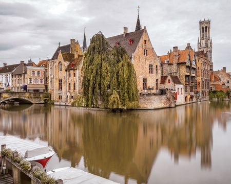 belfort: View from the Rozenhoedkaai in Brugge with the Perez de Malvenda house and Belfort van Brugge in the background in morning light. Creative tonning effect