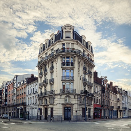 north window arch: Old central Lille, Rue Solferino street with beautiful corner building