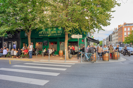 north window arch: Lille, France, Nord-Pas-de-Calais - August 14, 2015: Your people hanging out at Afterhours irish pub in  Rue Solferino street