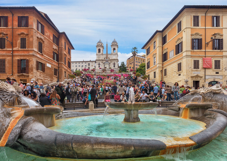 monti: Rome, Italy - May 2, 2011: Spanish steps and Ugly Boat fountain surronded by hundreds of tourists with Trinita dei Monti church on background Editorial