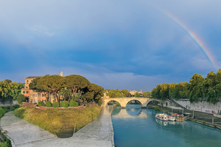 pons: View of ancient Tiber island and Pons Cestius bridge with rainbow, Rome, Italy