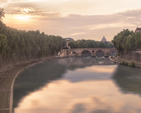 pons: View of Tiber river and Ponte Sisto bridge on sunset with Saint Peters dome in background. Creative filter effect Stock Photo