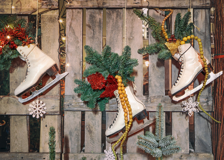 pinetree: Christmas decoration  with vintage skates and pinetree on wooden background Stock Photo