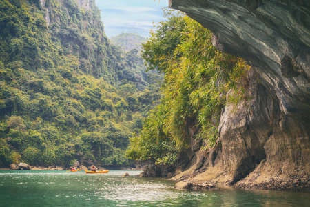 ocean kayak: Yellow kayaks on turquoise sea water in the cave of Halong Bay