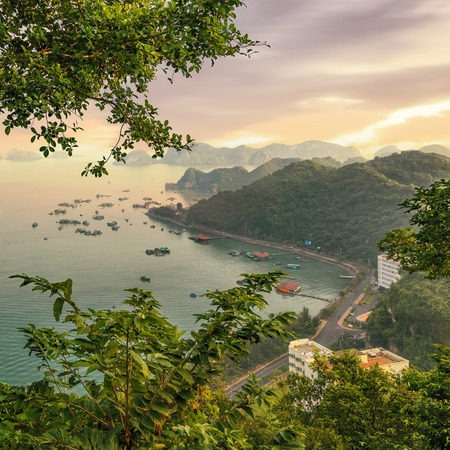 cat island: Cat Ba island from viewpoint with fishing boats in the ocean, Halong Bay, Vietnam Stock Photo