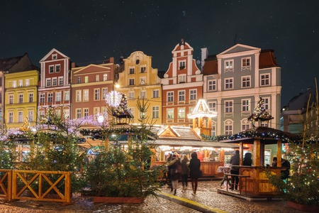 Christmas market in Europe. Old town of Wroclaw with glowing lights and pine trees