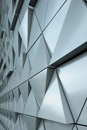 Abstract close-up view of modern aluminum ventilated triangles on facade Stock Photo - 51187679