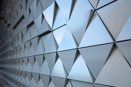 architectural exterior: Abstract close-up view of modern aluminum ventilated triangles on facade