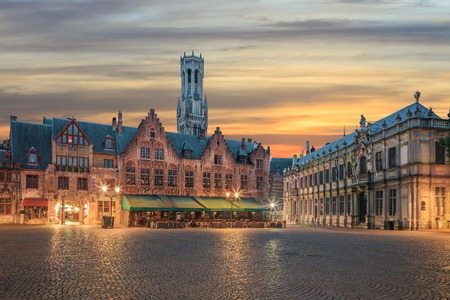 belfort: Belfort and Grote Markt square in old town of Bruges at sunrise Stock Photo