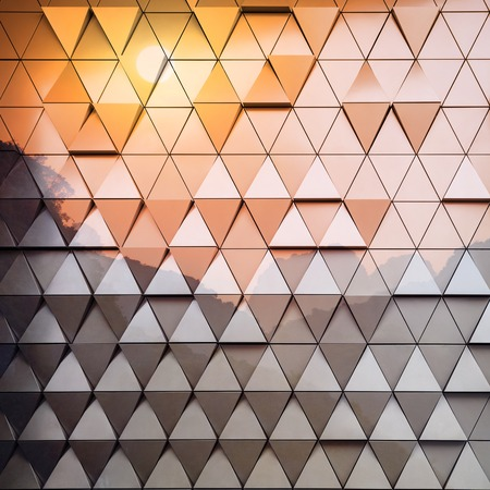 ventilated: Abstract close-up view of modern aluminum ventilated triangles on facade. double exposure creative effect