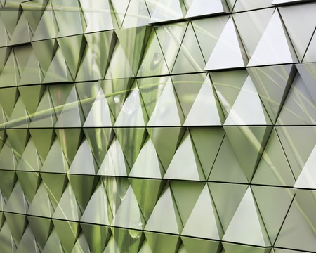 ventilated: Abstract close-up view of modern aluminum ventilated triangles on facade