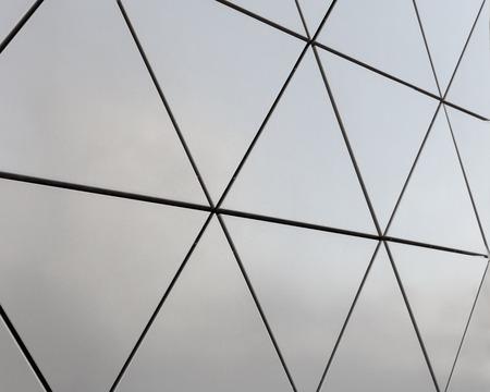 aluminium: Abstract close-up view of modern aluminum ventilated facade of triangles Stock Photo