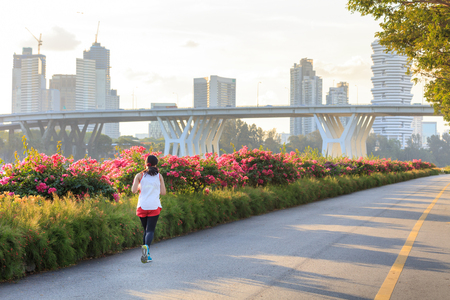 Jogger at Marina Bay East park at sunset