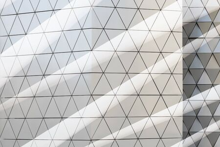 suspend: Abstract close-up view of modern aluminum ventilated facade of triangles. Double exposure. 3d illustration