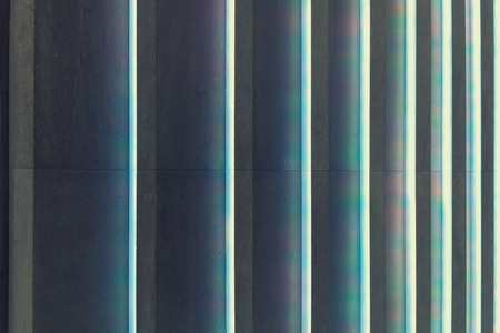ridges: abstract concrete stripes with colorful light ridges Stock Photo