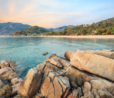 Beaches of Thailand. Empty morning beach with rocks on foreground
