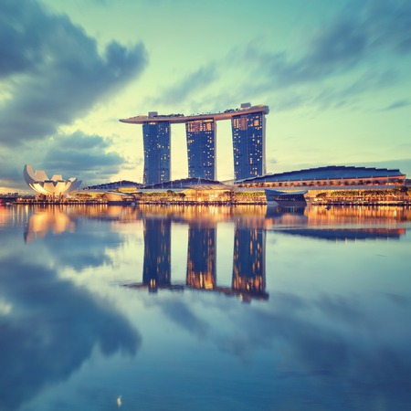 observation wheel: Singapore, Republic of Singapore - May 4, 2016: Marina Bay Sands hotel, ArtScience museum and Flyer observation wheel glowing at sunrise Editorial