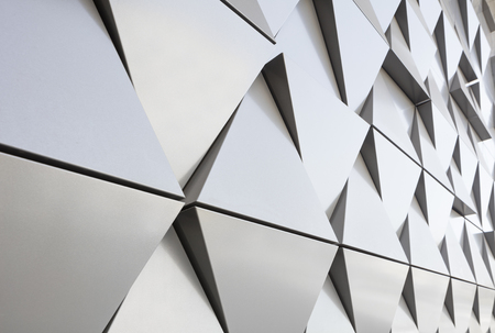 ventilated: Abstract photo close-up view of modern aluminum ventilated facade of triangles