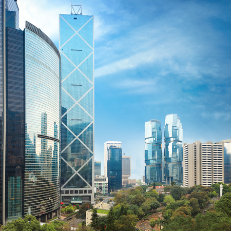 View on central area of Hong Kong with skyscrapers rising over Hong Kong Park Stock Photo