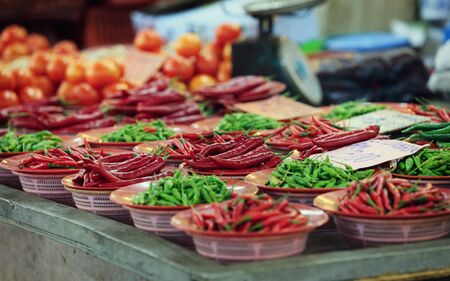 Traditional asian market with fresh green and red chili pepper Stock Photo