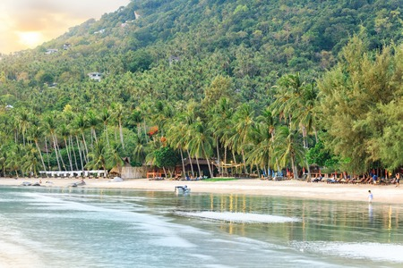 Sunset at Sairee beach with palmgrove during low tide Stock Photo