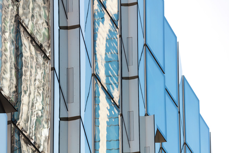 glazing: Abstract view of modern facade glazing with sky reflection Stock Photo