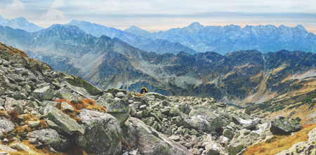 lonely tourist enjoys stunning panorama of Mieguszowiecki Grand Peak from Goat Peak, High Tatras, Zakopane, Poland