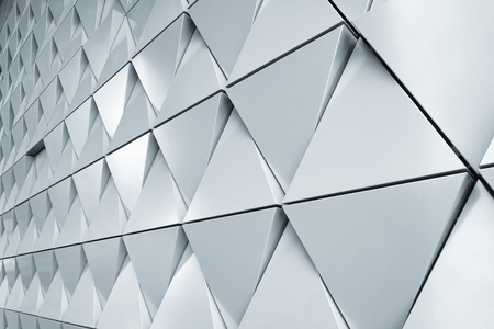 exterior architectural details: Abstract 3d illustration of modern aluminum ventilated triangles on facade