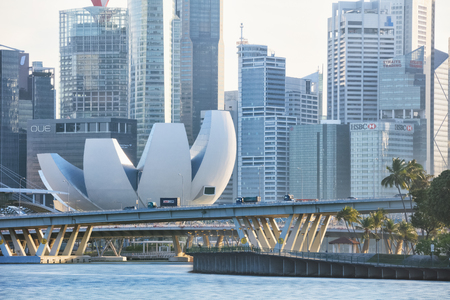 ave: Singapore, Republic of Singapore - May 4, 2016: evening traffic at Sheares Ave crossing Marina Bay Editorial