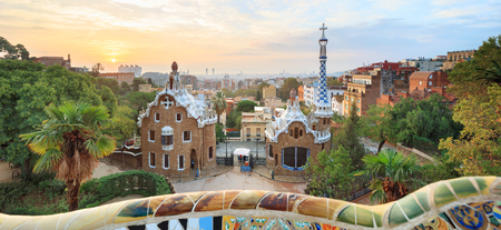 Park Guell in Barcelona. View to entrace houses with greenery on foreground Stock Photo