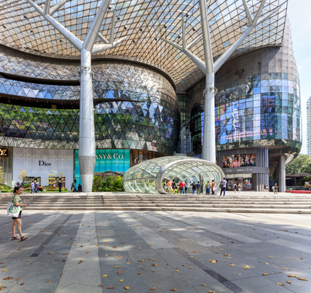 Singapore, Republic of Singapore - May 7, 2016: People shopping on Orchard road. Amazing architecture of ION Orchard shopping complex Editorial