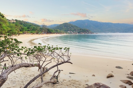 Empty morning Samui beach with beach rocks on foreground