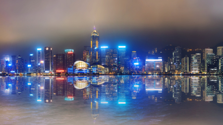 entertainment center: Hong Kong foggy night on Victorias harbour from Tsim Sha Tsui waterfront