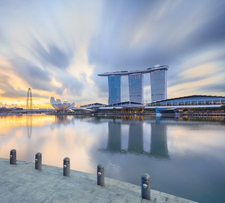 Singapore, Republic of Singapore - May 4, 2016: Marina Bay Sands hotel reflecting in sunrise water with steps on foreground Editorial