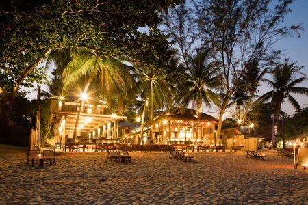 Evening Phangan beach glowing lights or bars and restaurants