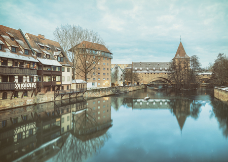 pedestrian bridges: Winter landscape of fortification with a tower Fronveste Schlayerturm on Pegnitz river in Nuremberg, Bavaria, Germany