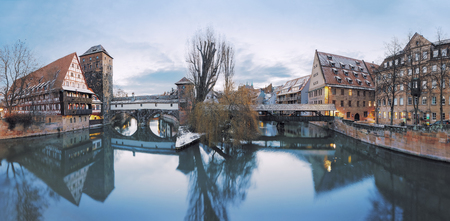 Winter panorama of Henker haus and Henkersteg bridge over Pegnitz river in Nuremberg, Bavaria, Germany Stock Photo